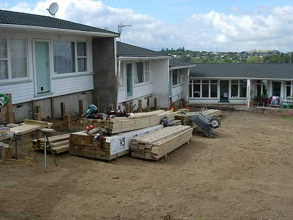 Block of 6 units, level gardens, re-peg out areas, install new fencing and decks.